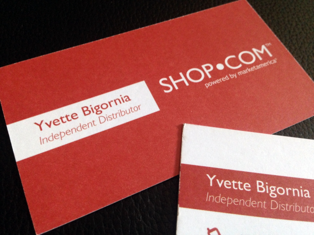 Close up of Shop.com business card.
